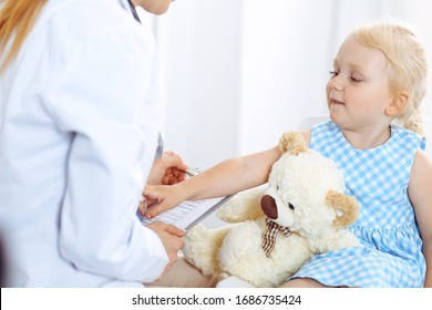 Happy smiling child patient at usual medical inspection. Doctor and patient in clinic. Medicine, healthcare concepts
