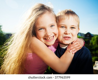 Happy smiling child at summer. Boy and girl outdoors