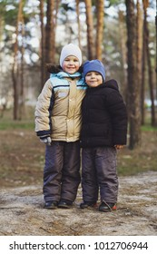 Happy, smiling children, children, boy playing in nature in the park, in the forest. Two brothers