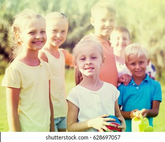 happy smiling children standing together outdoors on sunny day. Selective focus