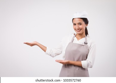 happy smiling confident asian woman pointing up, domestic worker pointing, domestic helper, woman housekeeper, girl shopkeeper, housewife pointing up, girl cleaner suggesting, woman maid, girl cleaner