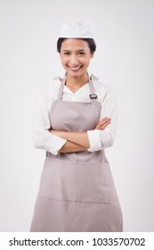 happy smiling confident professional asian woman domestic worker, domestic helper, woman housekeeper, girl shopkeeper, housewife, girl cleaner, woman maid, girl cleaning service staff studio portrait