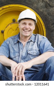A happy smiling contruction worker.