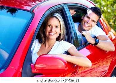 Happy smiling couple in a car. Driving.