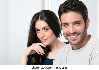 Happy smiling couple looking together at camera