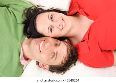 Happy and smiling couple lying on the floor