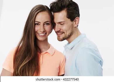 Happy smiling couple in white studio