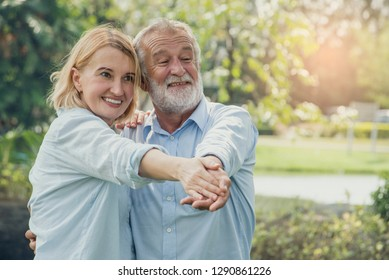 Happy smiling elderly couple in love happy  and  dancing romantic in park.Healthy lifestyle concept.