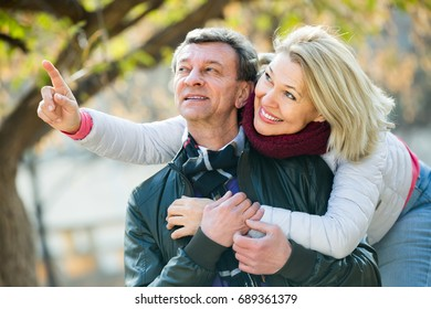 Happy smiling elderly couple spending time outdoors and enjoying together