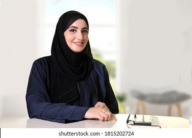 Happy smiling Emirati Arab woman wearing traditional Abaya and Hijab