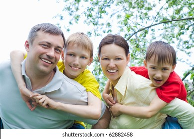 happy smiling famaly resting on the nature