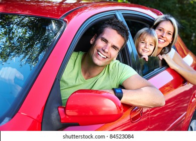 Happy smiling family and a family car.