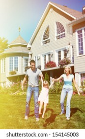 Happy smiling family with child over  house background