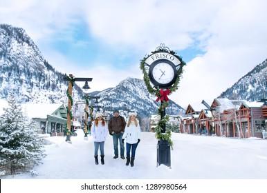 Happy ,smiling family enjoying beautiful  Colorado mountain town on winter  holiday trip. People on winter vacation. Rocky Mountains. Frisco, Colorado, USA
