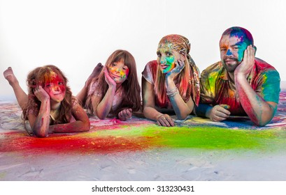 Happy smiling family in holi paint