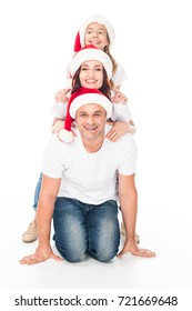 Happy smiling family in Santa hats, isolated on white