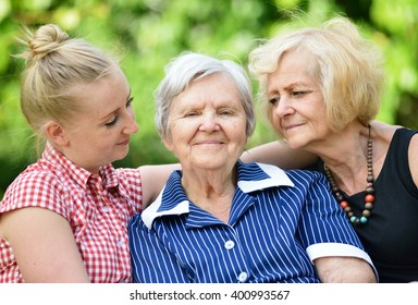 Happy and smiling family. Three generations of women. MANY OTHER PHOTOS FROM THIS SERIES IN MY PORTFOLIO.