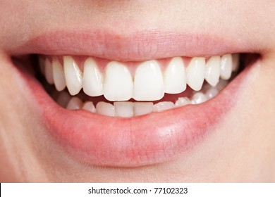 Happy smiling female mouth with white teeth