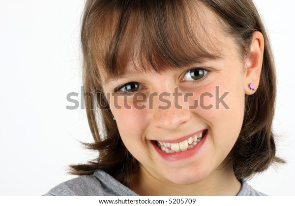 Happy, smiling girl against a white background