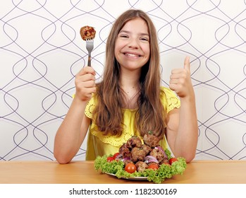 happy smiling girl with meatballs meal and thumb up