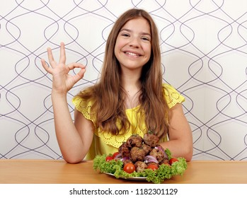 happy smiling girl with meatballs and ok hand sign