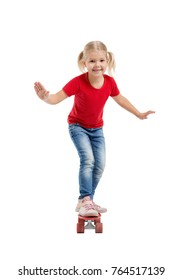 Happy smiling girl riding a skateboard isolated on white background