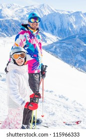 Happy smiling girl in ski goggles and with her father, Zellertal, Austria