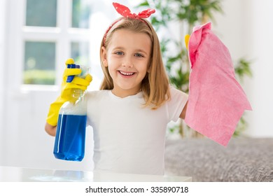 Happy smiling girl successful doing housework obligations