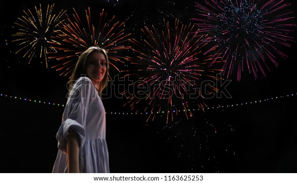 Happy smiling girl watching fireworks