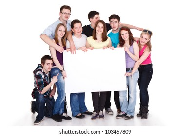 Happy smiling group of friends standing together in a row and displaying a white banner