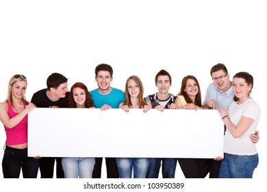 Happy smiling group of friends standing together in a row and displaying a white billboard