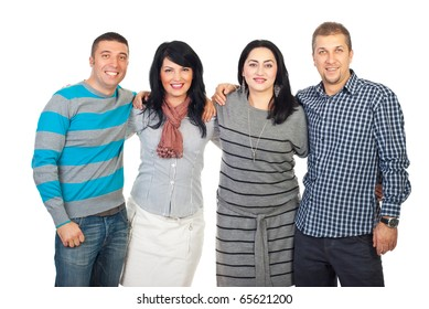 Happy smiling group of friends standing in a long embrace in a row isolad on white background