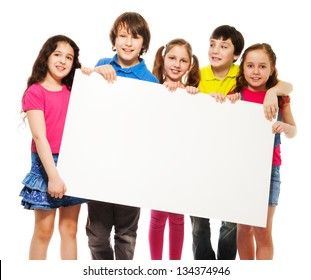 Happy smiling group of kids, friends, boys and girls, showing blank placard board to write it on your own text isolated on white background