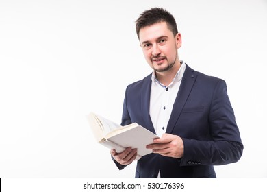 Happy smiling guy in suit holding book and looking at camera over white background