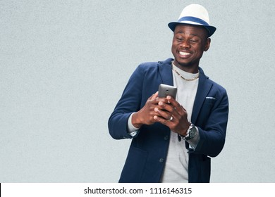 Happy smiling handsome business man with  a mobile phone