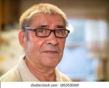Happy smiling healthy young looking senior man portrait. Closeup, shallow DOF.
