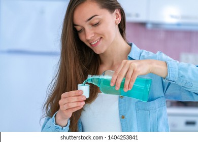 Happy smiling healthy young woman using a mouthwash gel to rinsing  mouth, fresh breath and dental health. Oral hygiene and teeth care