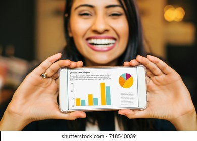 happy smiling indian woman showing graphs on phone screen