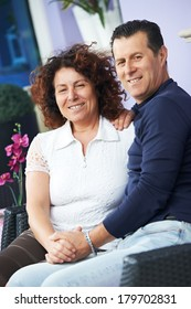 Happy smiling italian adult people couple outdoors