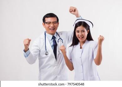 happy smiling joyful doctor and nurse, successful medical team