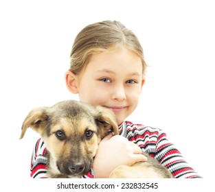 Happy smiling kid is holding a puppy on a white background isolated