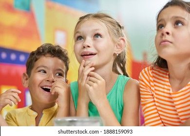 Happy smiling kids. Joyful children having fun in entertainment center. Childrens positive emotions.