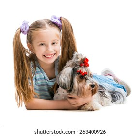 Happy smiling little girl is with her dog Yorkshire Terrier isolated on white backdround