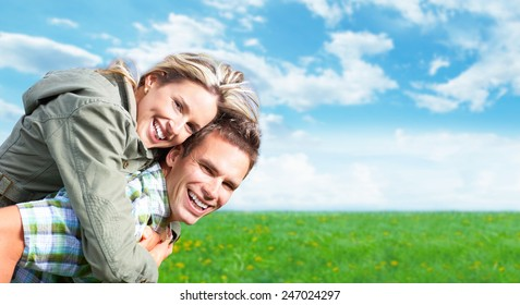 Happy smiling loving couple enjoying outdoors. Summer vacation