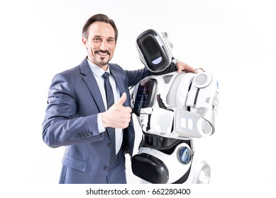 Happy smiling male person embracing cyborg