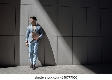 Happy smiling male person holding papers