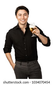 Happy smiling man in a black shirt and pants, holding a great cold beer in his hand with a big smile on his face. White background.