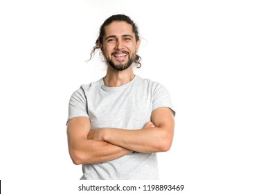Happy smiling man. Portrait young handsome male with beard, mustache and trendy hairdos on the white background.