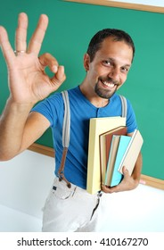 Happy smiling man showing okay gesture. Photo of smiling adult teacher, creative concept with Back to school theme
