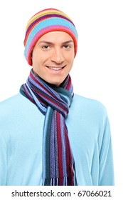 A happy smiling man wearing a hat and scarf posing against white background